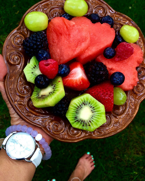 Snack of kiwi, heart shaped watermelon, grapes, raspberries, blackberries and strawberries